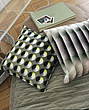 Modern urban lifestyle , patterned  cushions on a wooden floor - 9784-260-1