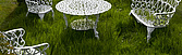 White painted wrought-iron garden furniture on long grass - 12343-80-1