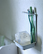Close-up of toothbrushes and soap in old enamel rack - 24205-60-1
