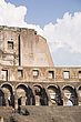 Crumbling upper tier is reinforced with modern brickwork at the Colosseum, Rome, Italy - 12035-40-1