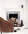 Brown armchair beside fireplace in modern living room - 24267-240-1