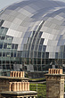 The Sage Gateshead (RIBA Inclusive Design Award) seen over rooftops with yellow and orange chimney stacks, Newcastle Upon Tyne, UK - 31876-110-1