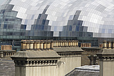 The Sage Gateshead (RIBA Inclusive Design Award) seen over rooftops with yellow and orange chimney stacks, Newcastle Upon Tyne, UK - 31876-80-1