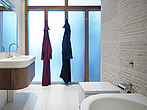Two bath robes hanging in a modern bathroom - 12523-200-1