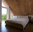 Bedroom with brick vaulted ceiling, zero carbon house, Crossway, Kent, England, UK - 12552-290-1