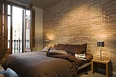 modern brown bedroom with bare brick wall and full-length window - 12676-20-1