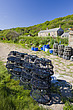 A row of coastal coattages and stacks of crab pots at Penberth, Cornwall, England, United Kindom, UK, Europe - 12877-90-1