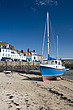 Colourful blue boat on the sand in Gorey Harbour, Gorey, Jersey, Channel Islands - 12881-30-1