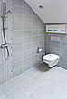 Wall hung lavatory in tiled wet room - 12922-110-1