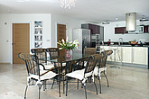 Open plan kitchen and dining area in Moonraker house, Exmouth, Devon, UK - 12957-140-1