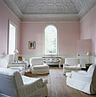 A contemporary style of comfortable seating in white loose covers has been struck in this neoclassical drawing room with pale pink walls and coffered... - 60000-320-1