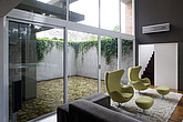 Living room with view to courtyard exterior of Marcos Bertoldi Brick House, Curitiba, Brazil  - 12976-30-1