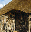 The walls of this thatched folly are made from rough knotted wood, Northamptonshire, England, UK - 60140-70-1