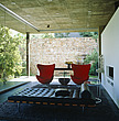 Glass-walled living room with pair of red Egg chairs and a Barcelona chaise longue, South Africa - 60183-60-1