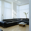 Vast black leather L-shaped sofa in a high-ceilinged living room - 60229-10-1