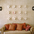 White hats above wicker sofa with cushions, Plettenberg Bay, South Africa,  - 60246-10-1