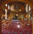 Grand piano and chairs set up for a concert in the wood panelled hall at Castle Ashby - 60338-40-1