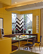 Banquette in kitchen seating area with white zig-zag sculptural column in garden beyond, UK - 60792-10-1