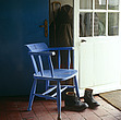 A blue painted kitchen chair and a pair of discarded boots by the open back door - 61138-10-1