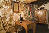 Antique chairs, table and furnishings in the cellar which was once used to store vegetables in an Old Canadiana (circa 1840) cottage style Residential... - 13559-400-1