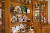 Dressers in the kitchen of a reconstructed Canadian cottage style residential log home, Quebec, Canada - 13561-40-1
