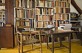 Bookcases, antique chair and table in the upstairs study room of an Old Canadiana (circa 1810) Cottage style residential home, Lanaudiere, Quebec, Can... - 13559-610-1
