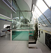 Steps up to custom made glass swimming pool in Paxton House, London, UK - 11655-140-1