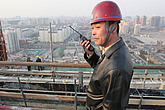Construction site foreman on roof of the project for travel agency CYTS, in Dongzhimen, Beijing, 2005 - 11592-10-1