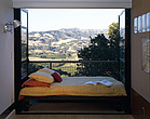 Mann Residence, Bedroom with french doors open onto balcony and landscape - 9984-210-1