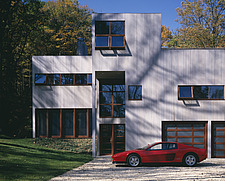 Modern timber boarded house with red car in rural woodland - 193-90-1