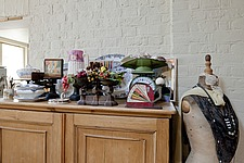 Wooden sideboard with ornaments and mannequin in Victorian home, Kingston upon Thames, England, UK - 12652-360-1