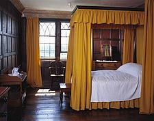 Bedroom with wood panelled walls and leaded window, Boscobel House, Staffordshire, UK - 32132-40-1
