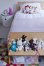 Soft toys on single bed in girls room of London home, UK - 13214-240-1
