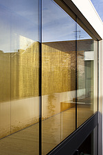 View through window glazing to gold leaf wall in Notting Hill townhouse renovation, London, UK - 13219-400-1