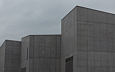 View of rear elevation of The Hepworth Wakefiled showing the angular details of the roof and walls against a dark gray cloudy sky - 13298-140-1