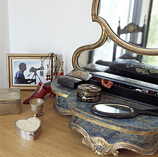 Ornate mirror on a dressing table - 13438-90-1