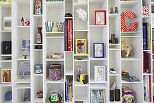 Assorted colourful objects arranged on white shelving by MDF Italia - 13552-90-1