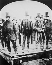 John Scott Russell (left), shipbuilder, Henry Wakefield, Isambard Kingdom Brunel and Lord Derby at the launch of the 'Great Eastern' at Millwall on 1s... - 32401-30-1