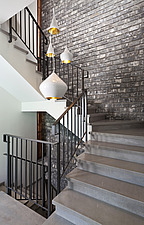 Stairwell with grey brick wall and metal banister in villa by Gadi Fiedman, Israel - 14828-100-1