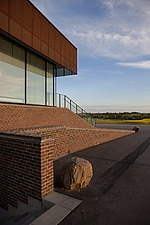 The new sports hall for Campus Ringsted, south of Copenhagen utilizes the enormous potential to orchestrate various functions in one contemporary arch... - 16247-40-1