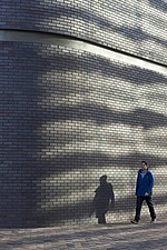 Curved brick wall with man walking - 16380-20-1