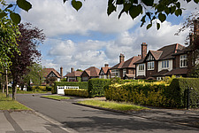 Large detached 1930's family homes in Nottingham, England seen from the roadside - 16382-20-1