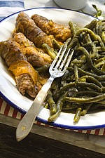 Rustic meal with green beans on white plate with fork - 16440-150-1