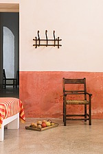 Mediterranean living room with chair and orange wall - 16440-620-1