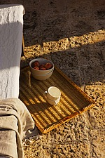 Wicker tray  with cups and bowl of fruit on stone floor - 16440-680-1