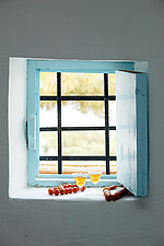 Barred casement window with turquoise bluepainted frame and shutter with two glasses of wine - 16440-720-1