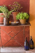 Rustic metal framed table with pots of herbs and lanterns - 16440-800-1