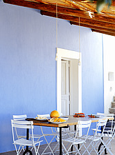 Al fresco dining table and chairs with blue wall - 16440-860-1