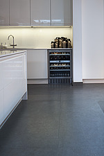 Interior view of residential building, kitchen with white kitchen counter and wine refrigerator - 16753-140-1