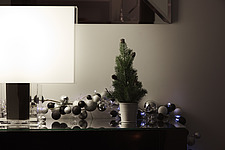Interior view of residential building, Christmas decorations and lamp on a sideboard - 16753-170-1